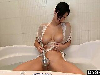 Busty Brunette Rubs Her Pussy In Bath Tub
