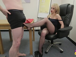 Naughty blondie Chessie Kay gives a footjob to a naked man