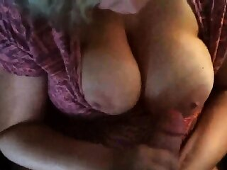 Chubby Ma Strokes An enormous number Onto Her Tit